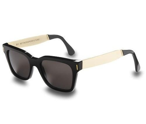 These iconic Ray-Ban Wayfarer sunglasses present timeless stylewith their thick black lenses and white temple accents. Made inItaly, these stylish sunglasses come with an official Ray-Bancarrying case and a cleaning cloth.